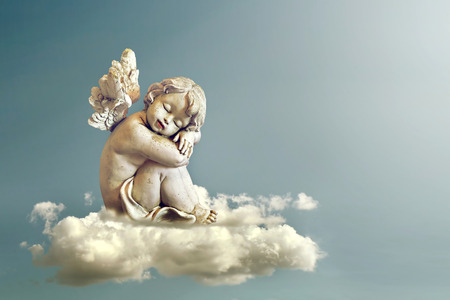 Angel sleeping on the cloud Banco de Imagens