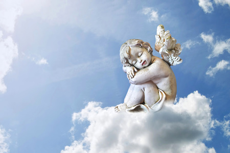 Little angel sleeping on the cloud Banco de Imagens