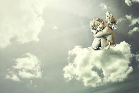 Angel sleeping on the cloud Imagens