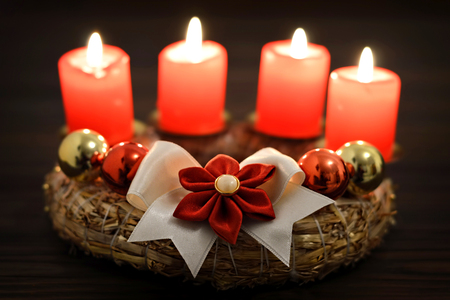 Christmas card: Four burning candles on Advent wreath