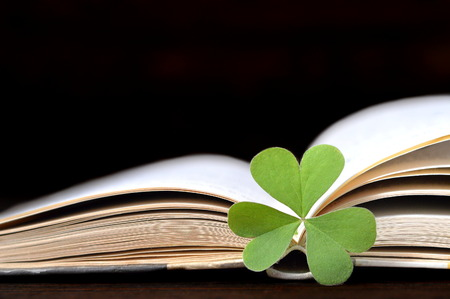false shamrock: Mothers Day card: Heart shaped leaves on the opened book