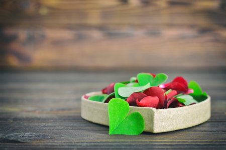 false shamrock: Valentines Day card with heart-shaped leaves and red rose petals