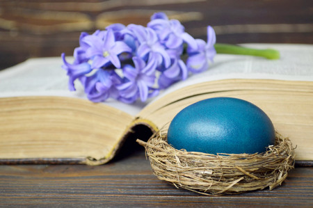 bible flower: Easter card with blue Easter egg and hyacinth flower on the book