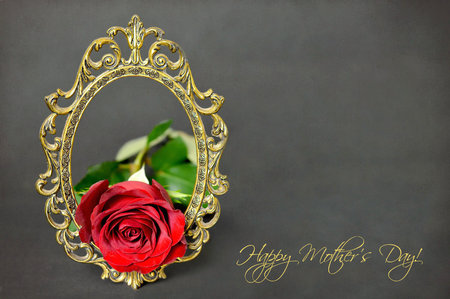 Happy Mothers Day: Red rose and vintage frame on dark grunge background Stock Photo