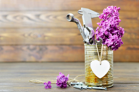 Fathers Day card with tools, heart and lilac flowers Stock Photo - 79595032