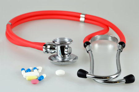 Stethoscope and pills Stock Photo