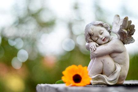 Angel guardian sleeping on the grave Zdjęcie Seryjne