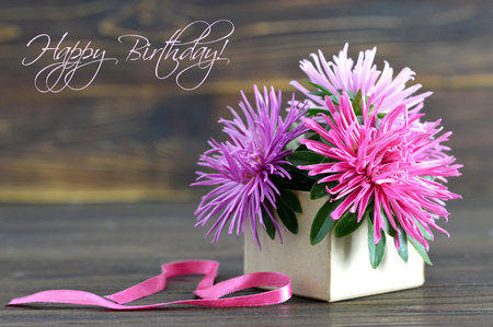Happy Birthday card with flowers arranged in gift box