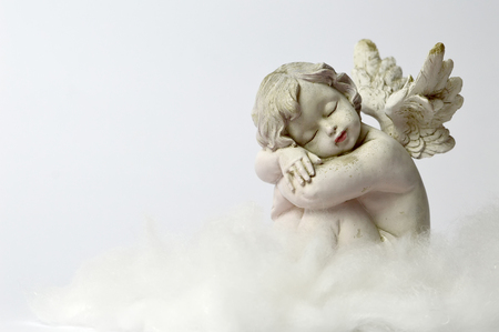 Angel sleeping on the cloud Stock Photo