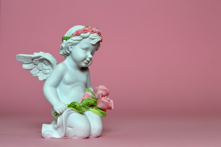 Angel on pink background