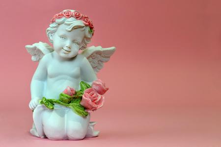 Guardian angel holding flowers