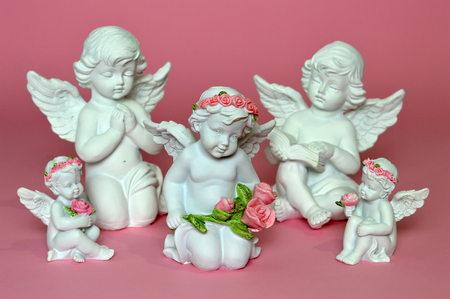 Group of little angels on pink background