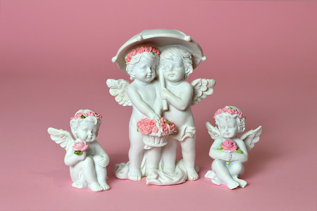 Group of little angels holding flowers