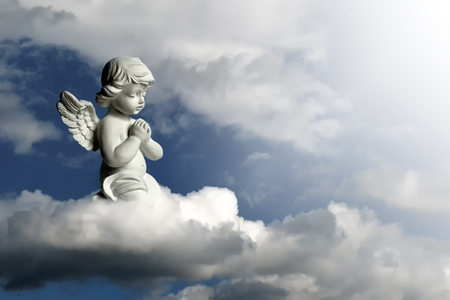 Guardian angel kneeling and praying. Angel guardian on the cloud
