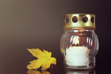 All Souls Day. White candle and autumn leaf Stock fotó