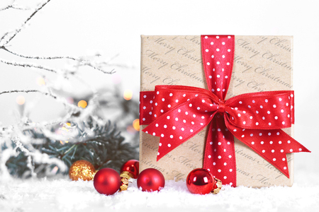 Christmas gift with red ribbon and red Christmas balls Stock Photo