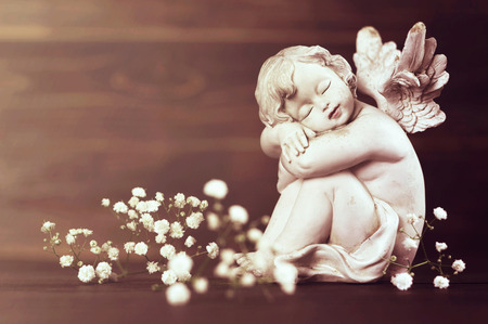 Angel and white flowers