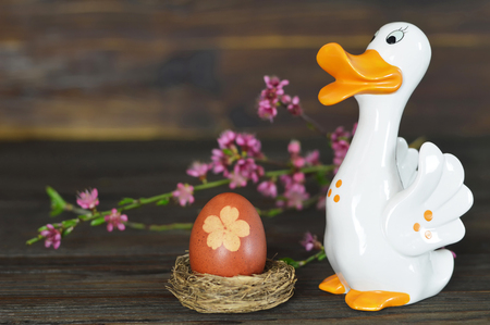 Easter egg in the nest and duck figurine