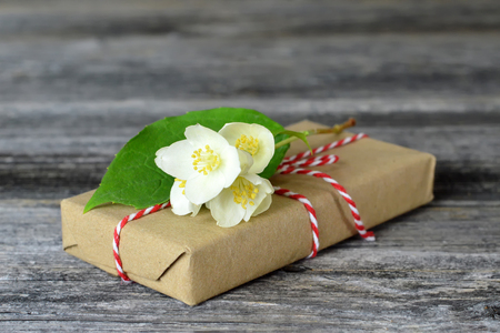 Gift box wrapped in brown paper decorated with jasmine flower 写真素材