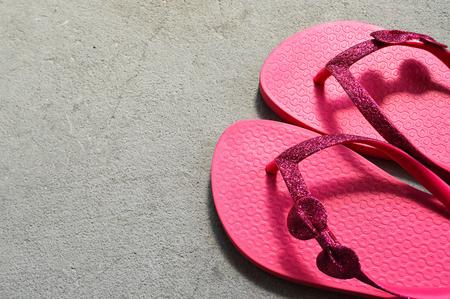 Flip flops on concrete background 写真素材