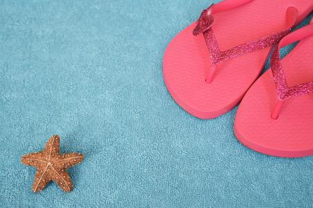 Flip flops on blue towel 写真素材