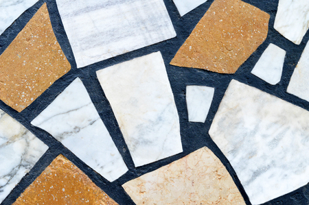 Asymmetrical stone floor tiles