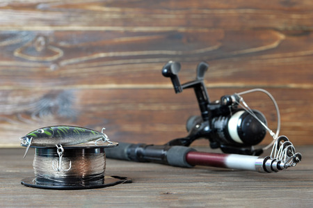 Fishing tackle on wooden board 写真素材