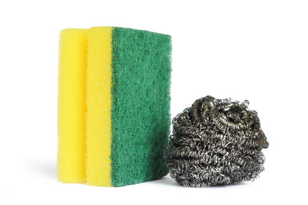 Stainless steel scrubber and kitchen sponge isolated on white Imagens