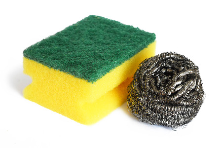 Kitchen sponge and stainless steel scrubber isolated on white