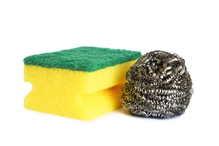 Kitchen sponge and stainless steel scrubber isolated on white background Imagens
