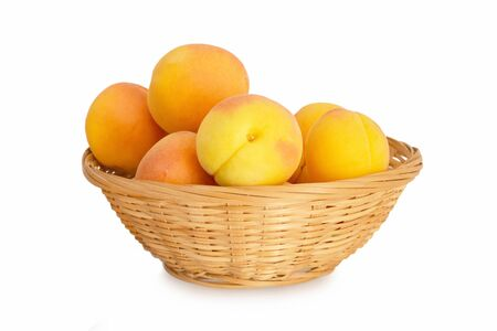 Apricots in bowl isolated on white background