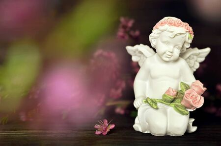 Cherub holding flowers