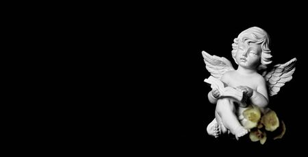 Condolence card with guardian angel on black background