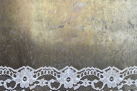 White lace on grunge background with copy space