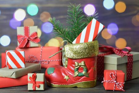 Santa's shoe and wrapped gifts