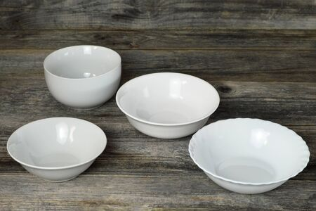 Empty white bowls on wooden background 写真素材