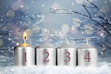 Four Advent candles. One candle burning. First week of Advent Stock Photo