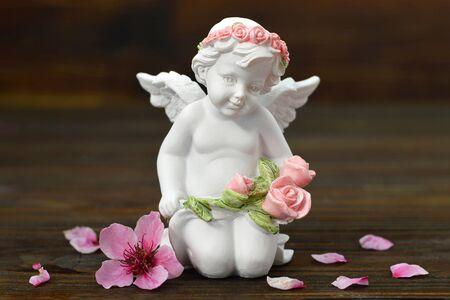 Cherub angel and spring flowers