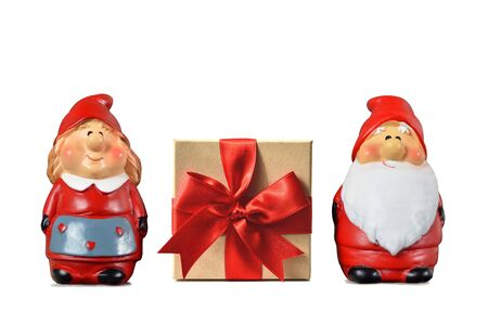 Christmas card. Santa Claus, his wife and gift box isolated on white background Stock Photo