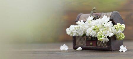 Wedding flowers in wooden vintage chest. Wedding decoration