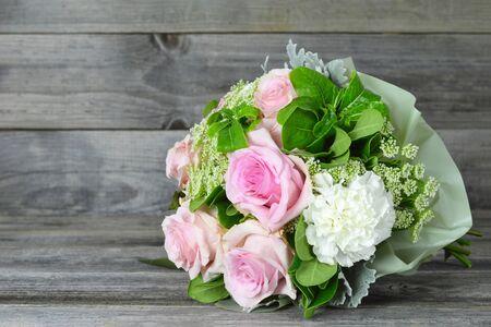 Bouquet of flowers on wooden background Zdjęcie Seryjne