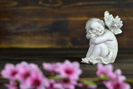 Guardian angel on wooden background
