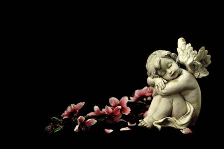 Guardian angel and spring flowers isolated on black