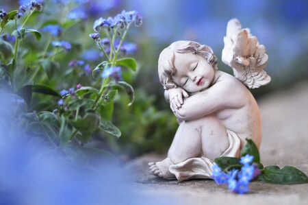 Little angel and spring flowers Stok Fotoğraf