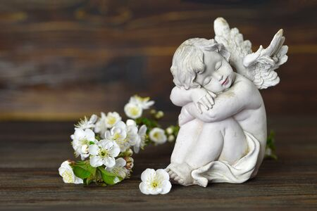 Guardian angel and white spring flowers