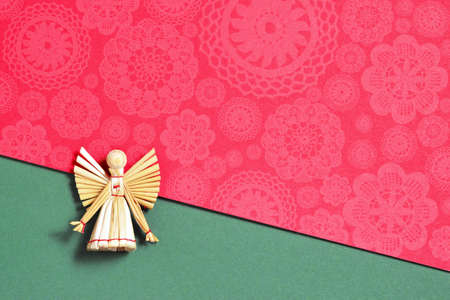 Christmas card with angel decoration made of straw