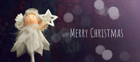 Cute Christmas angel holding Christmas star Banco de Imagens