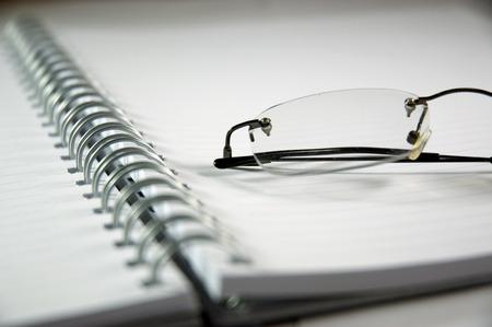 notebook and eyeglasses photo