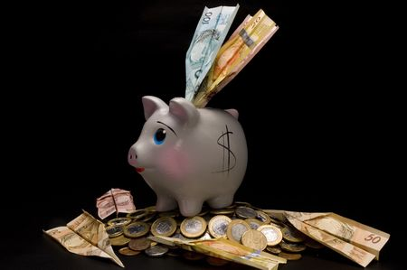 Piggy Bank with money and coins photo