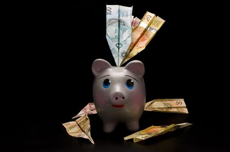Piggy Bank with money airplane photo